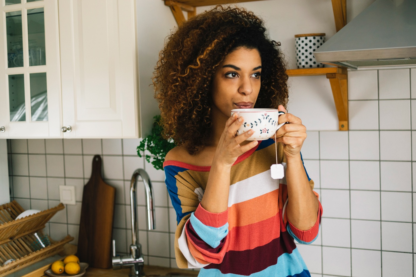 GettyImages woman drinking tea humanmade